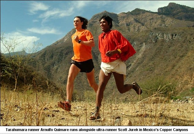 Tarahumara runner Quimare Arnulfo runs with ultra runner Scott Jurek in Mexico's Copper Canyons, notice the Huaraches or thin sandals